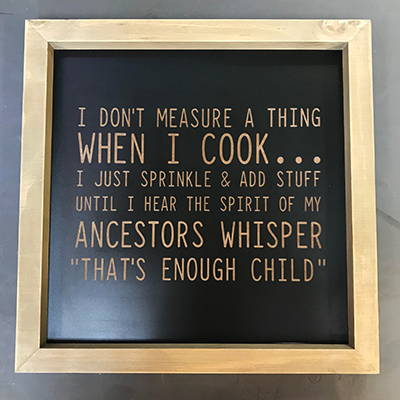 Funny cooking quote engraved onto a wood plaque.