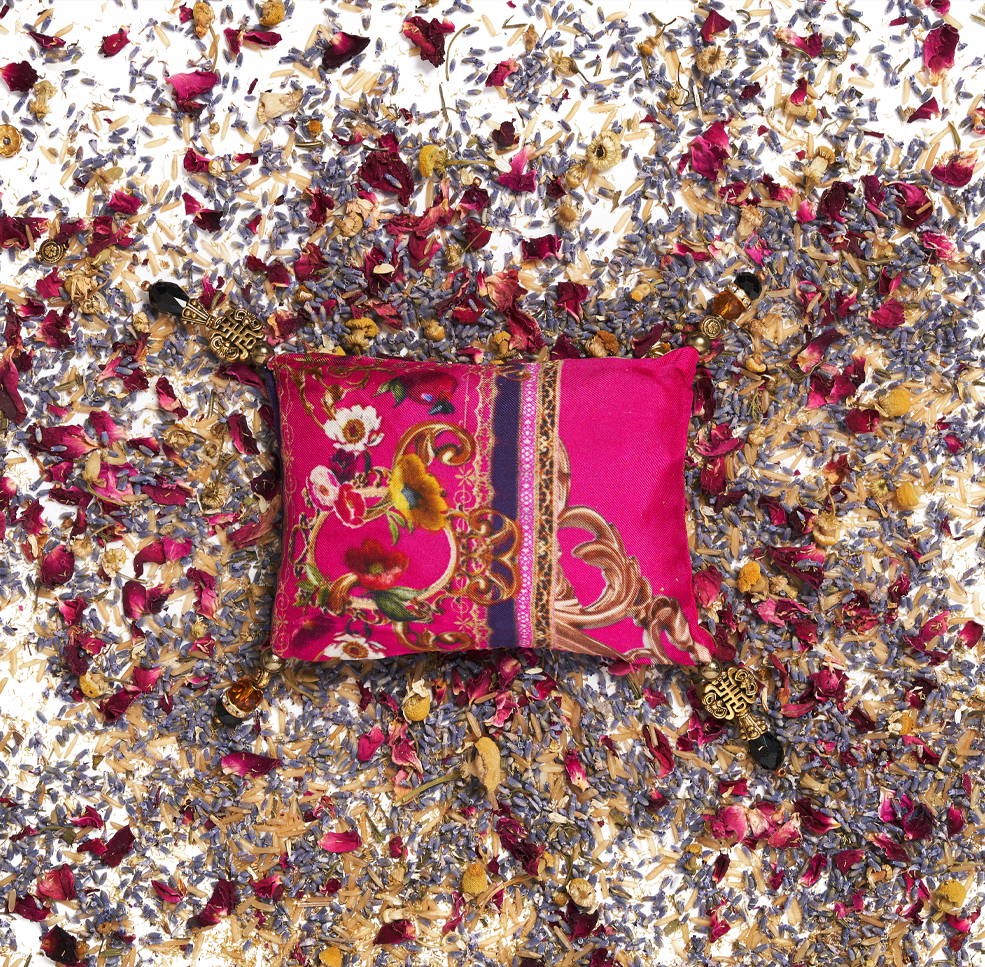 CAMILLA pink printed lavender bag with dried florals scattered around