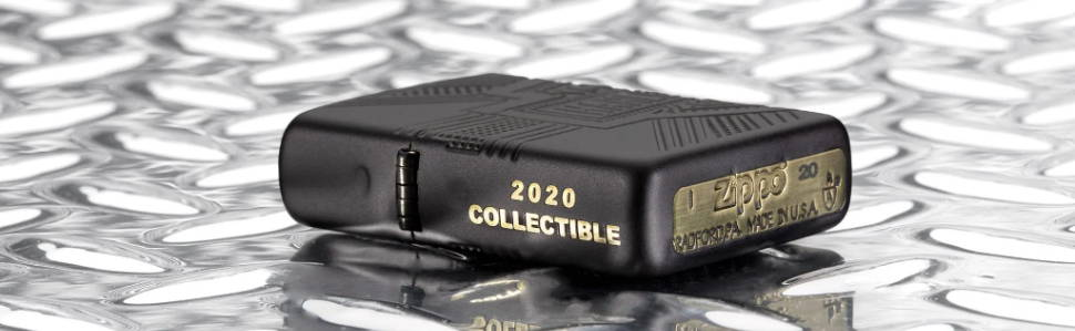 2020 Harley-Davidson® Collectible lighter, laying flat on a metal surface, showing hinge side with 2020 collectible engraving