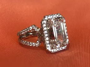 one of a kind emerald cut diamond engagement ring