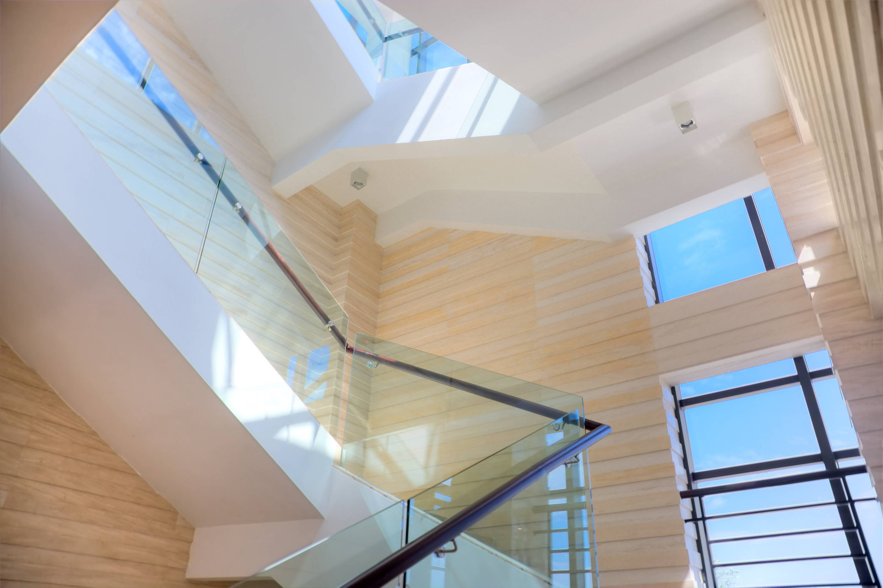 Glass railing with metal handrails