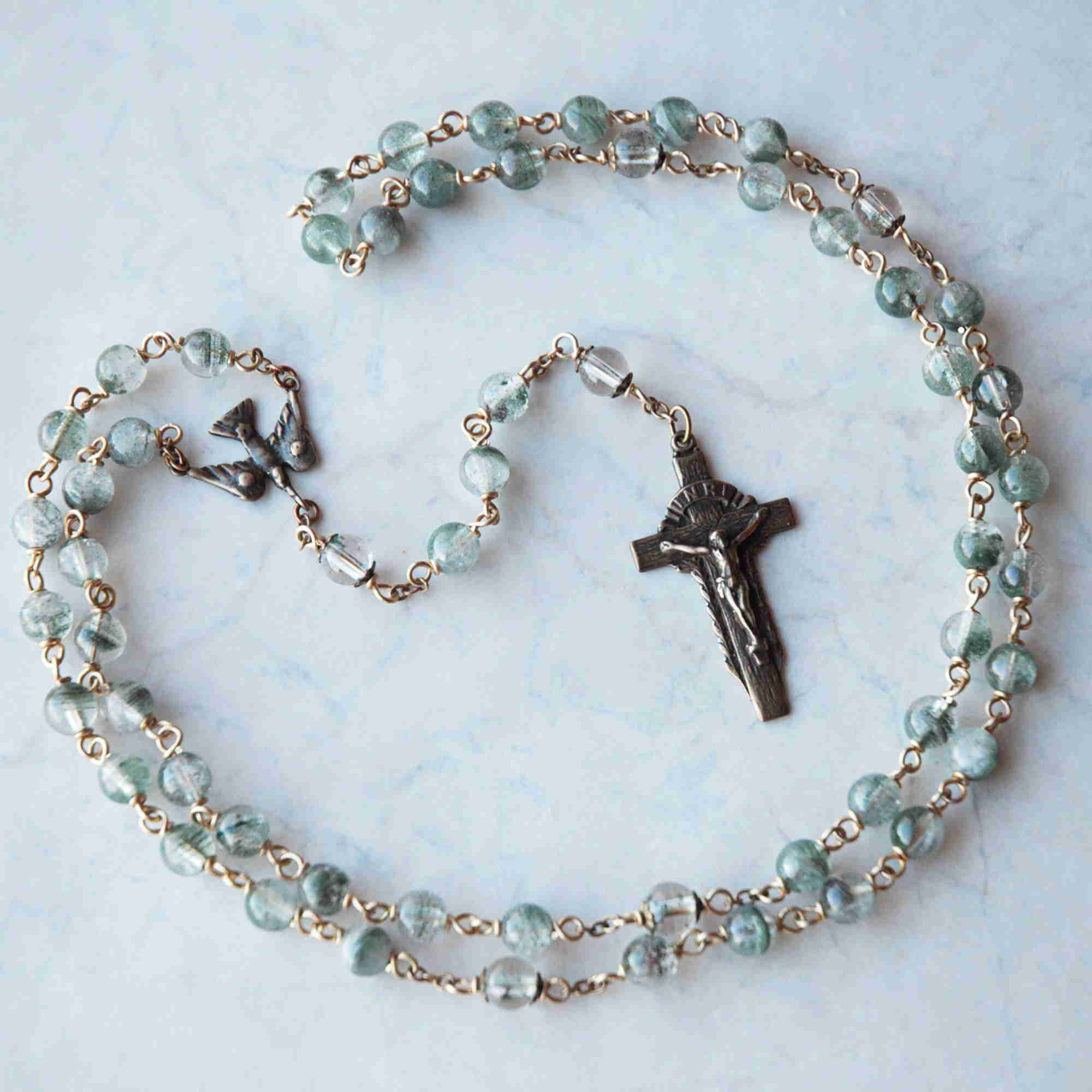 Bronze handmade rosary in Green Striae Lodalite by Jennifer Sinclair, owner of Miracoli Rosaries