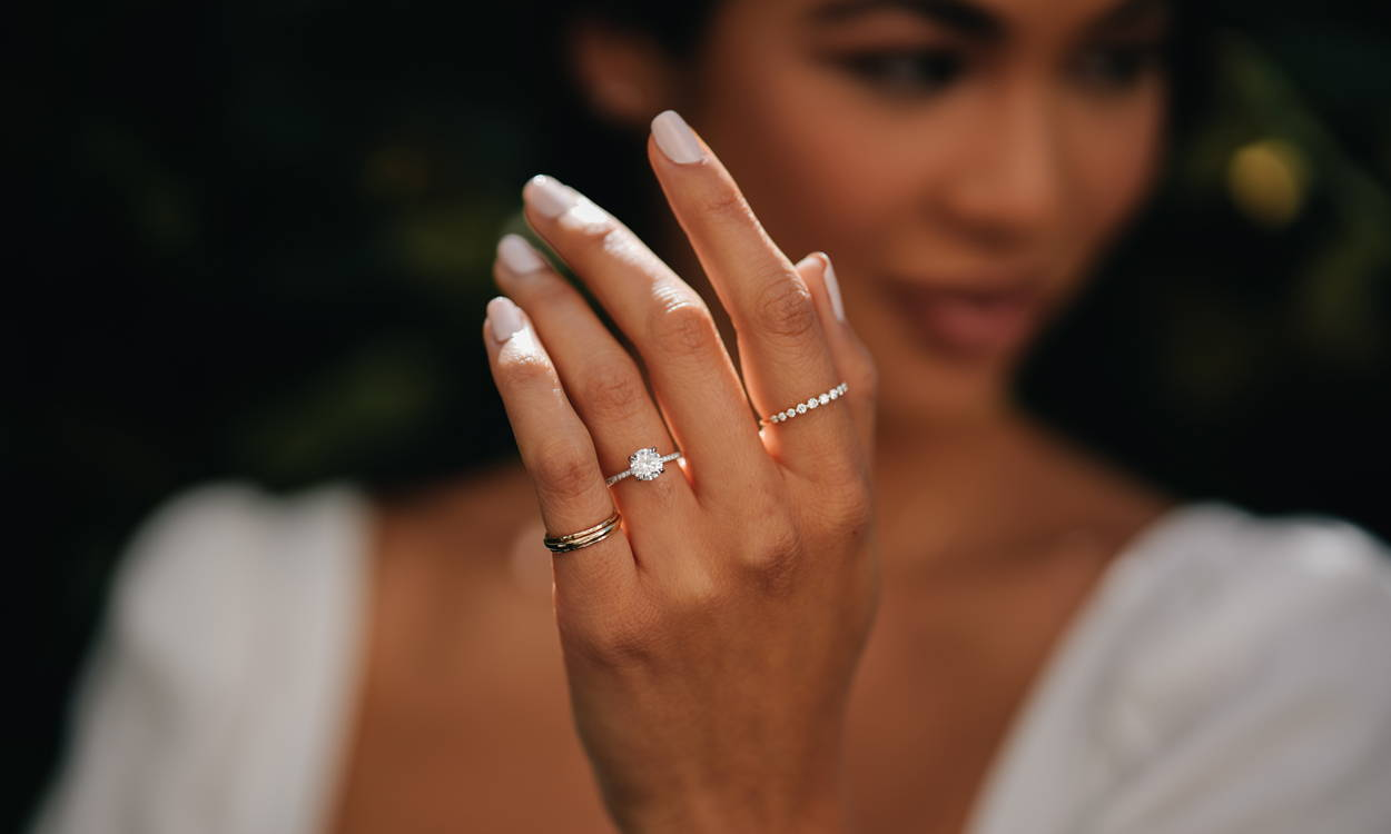 Model wearing VOW by Ring Concierge engagement ring
