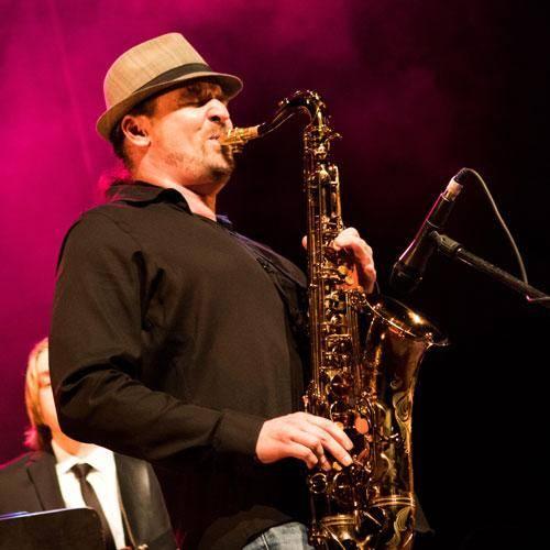 Saxophonist David Halliday playing tenor saxophone