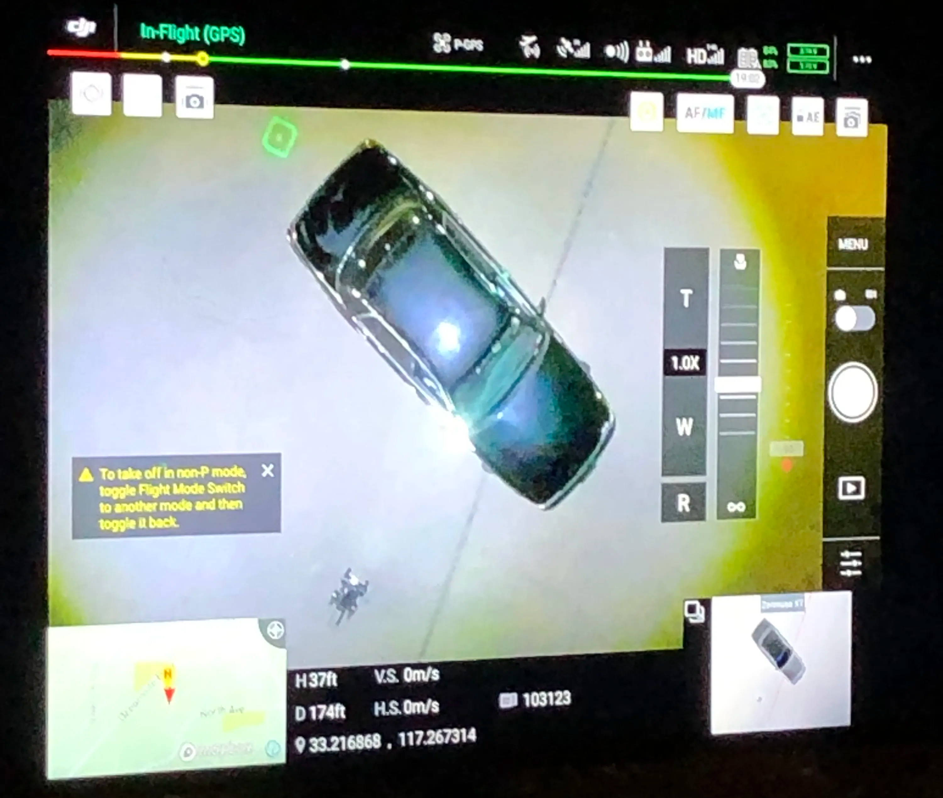 An aerial view from the control center of the drone over top of the vehicle.