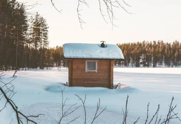 wooden shed in the snow