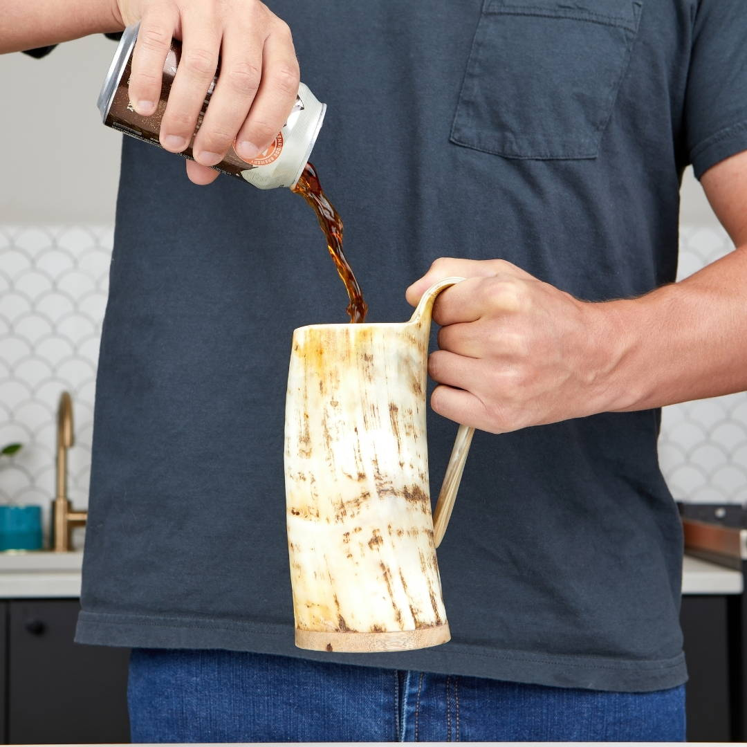 Grand ox Viking drinking horn. Every Viking horn is made of authentic, ethically sourced ox horn (Certified Livestock Certificate), painstakingly selected for appearance, durability, color pattern and shape. Each Norse inspired tankard is unique in shape & color & comes packaged in a medieval burlap sack. It's time that you chose a drinking vessel as interesting as you!