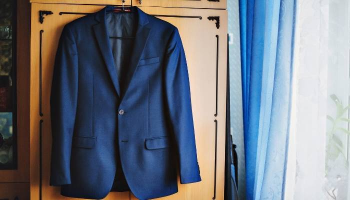 Suit jacket hanging on wardrobe