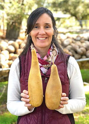 Phoebe holding 3-3.9 inch diameter People Gourds, 9-14 inches tall