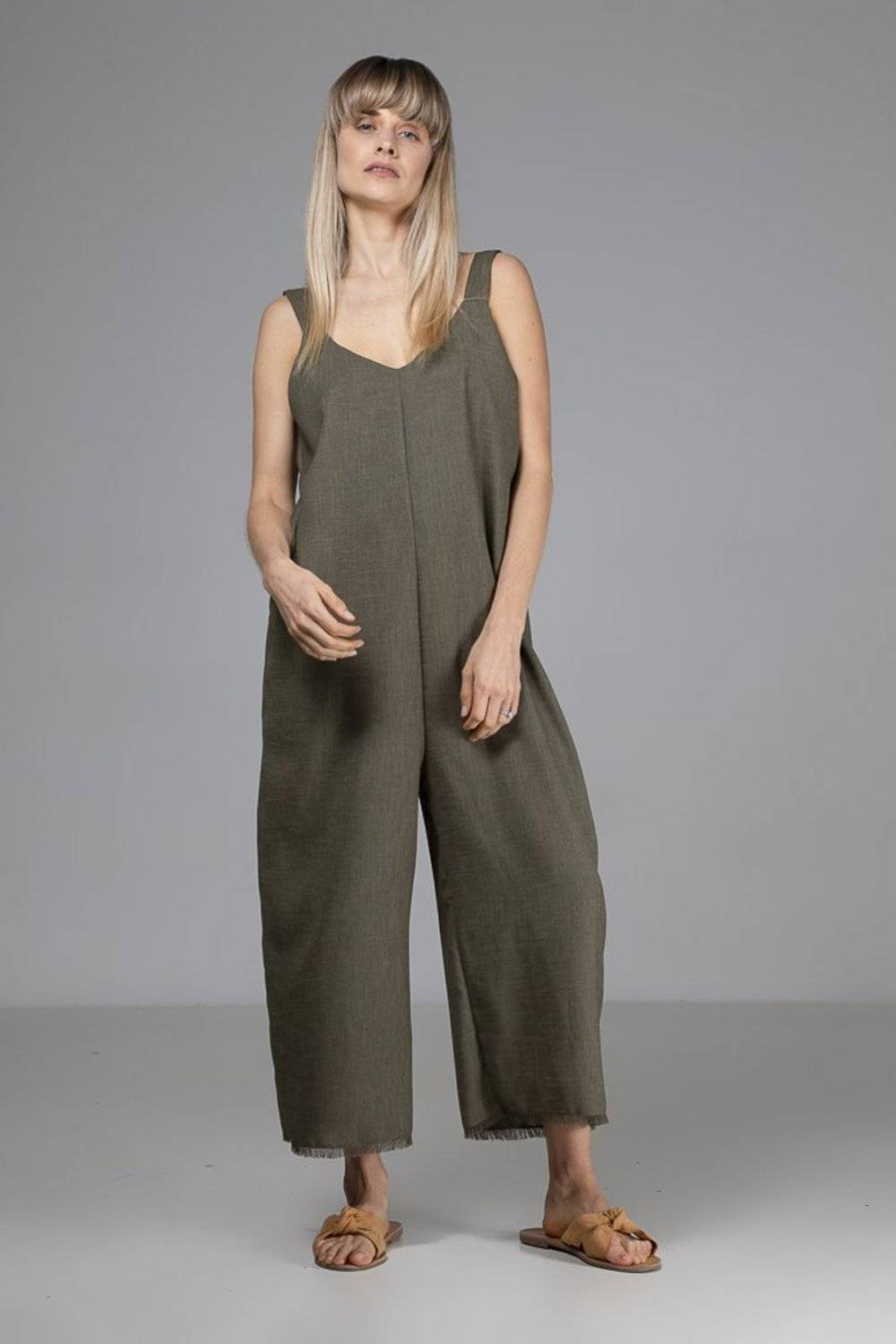 The surplus fabric Green Sadie Jumpsuit by Indecisive is a light and comfortable oversized 3/4-length jumpsuit with a daring plunging back.