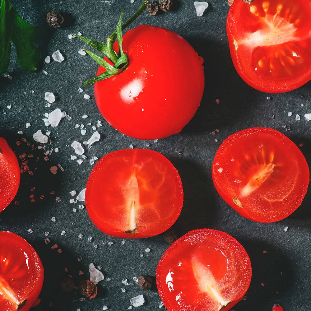 High Quality Organics Express Kosher salt on cherry tomatoes