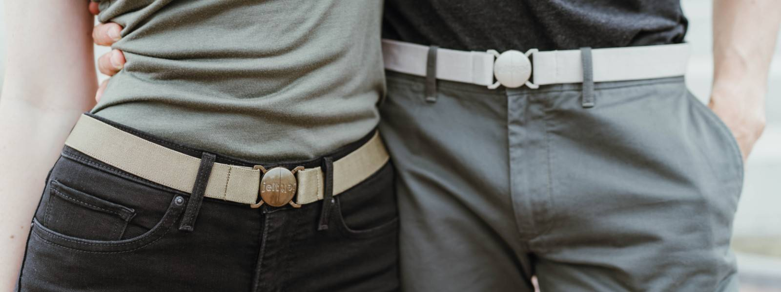 Jelt Belt Khaki Collection featuring Khaki Green and Khaki Tan elastic stretch belts. Pictured on a couple.