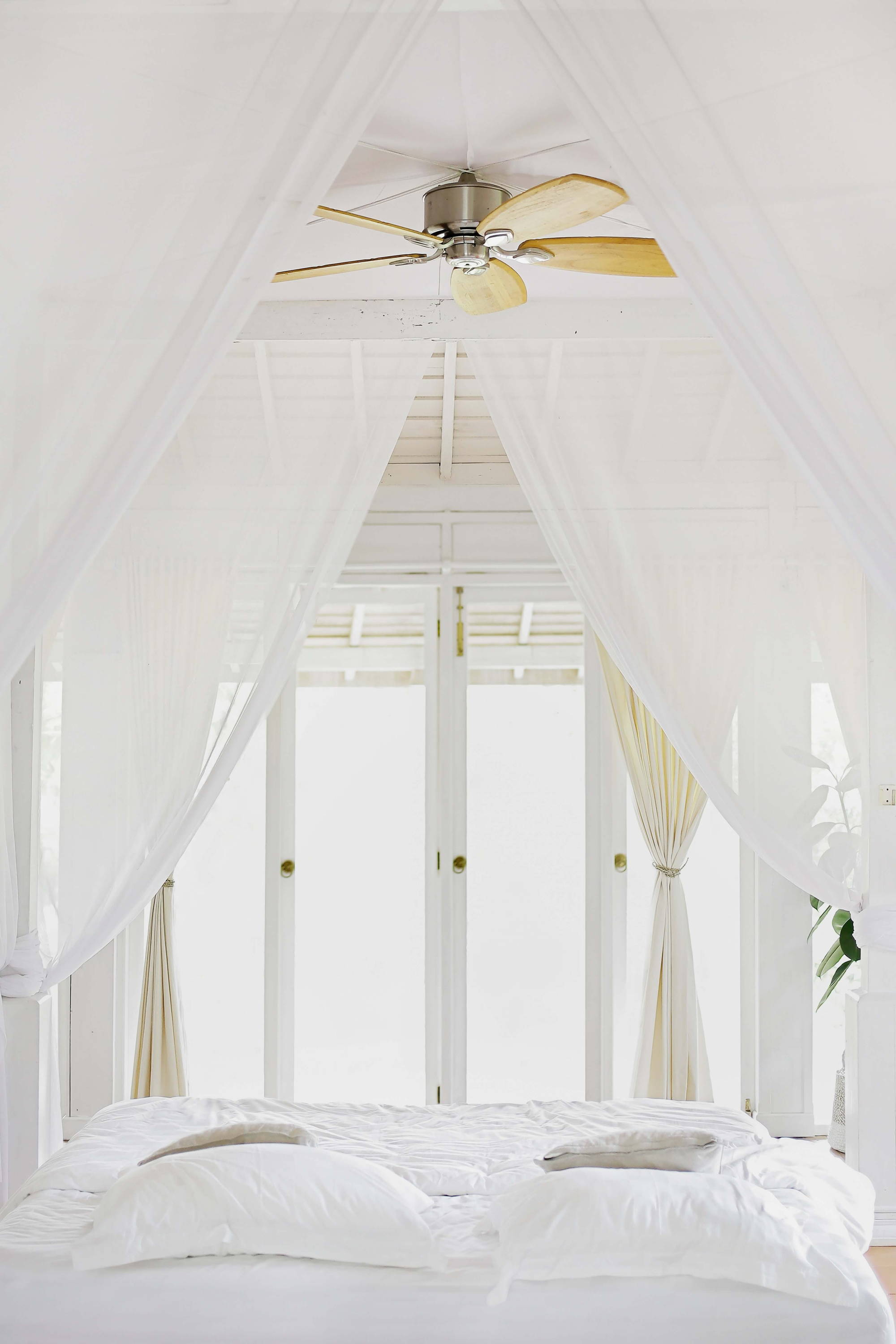 A bedroom in white with Eucalypso's Tencel lyocell sheets