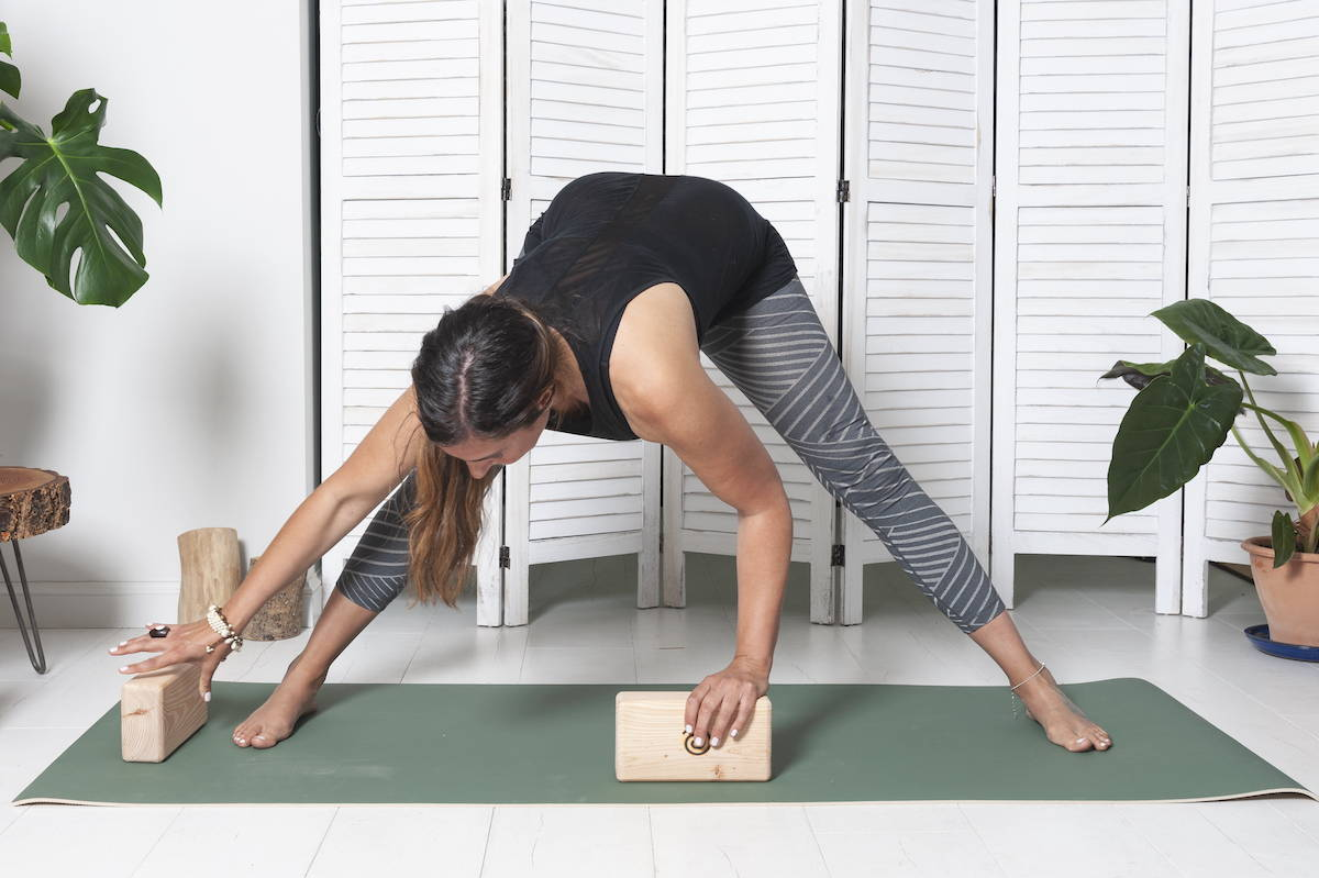 reaching-for-a-wooden-yoga-block