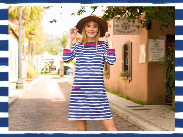 Woman wearing Boston Cabana Shift Dress on street with brown hat