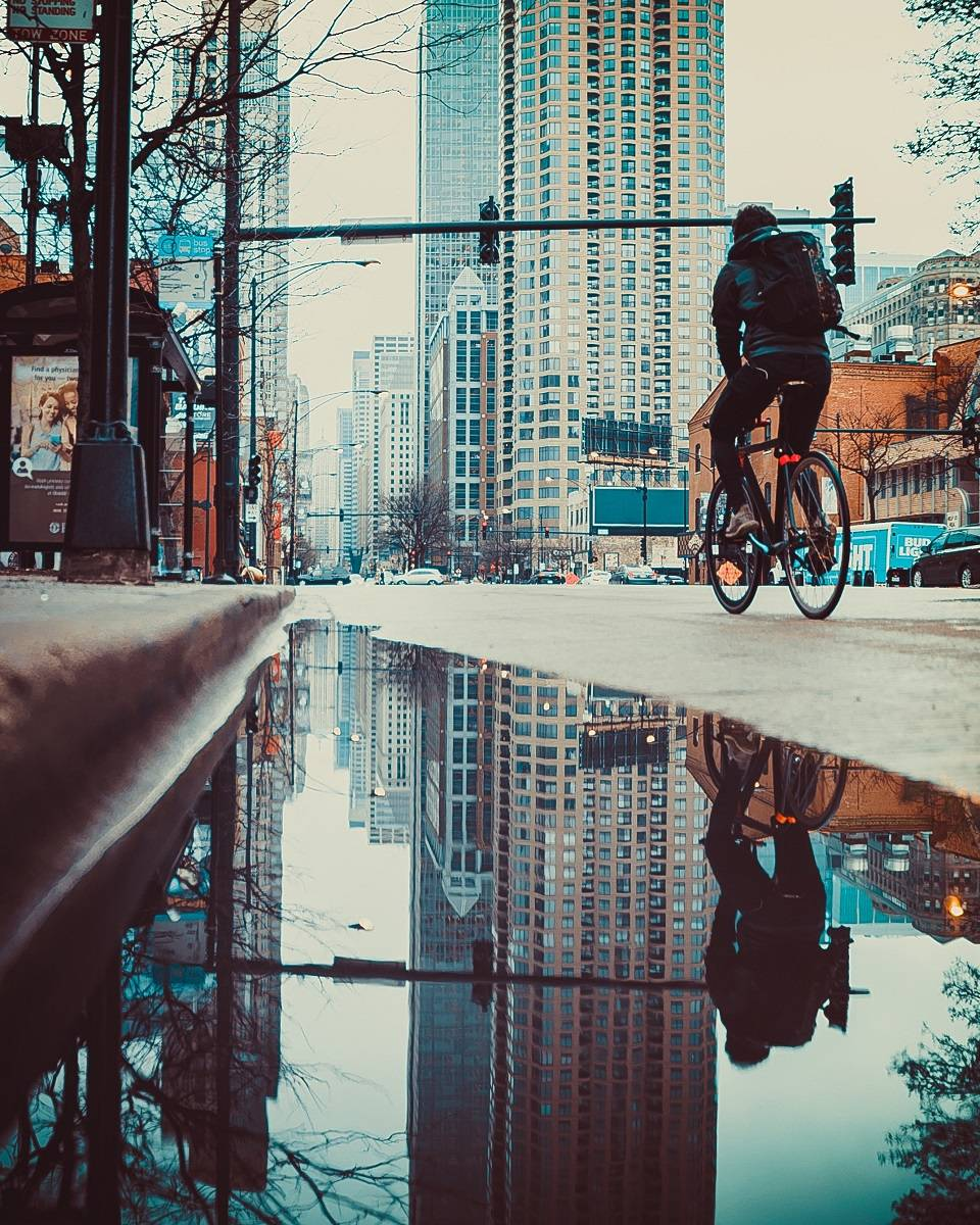 A man riding to work in a city