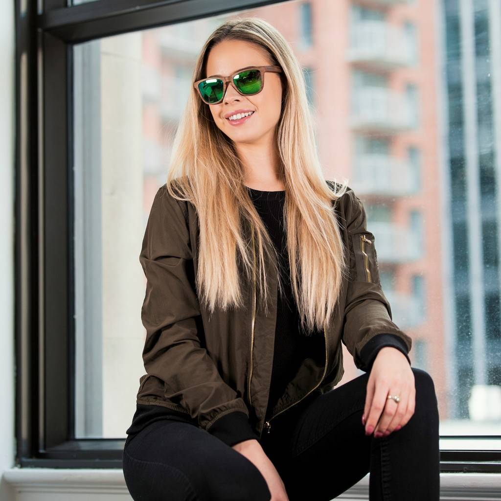 Woman wearing Kraywoods Racer, Square Sunglasses made from Walnut wood with Polarized Green Lenses
