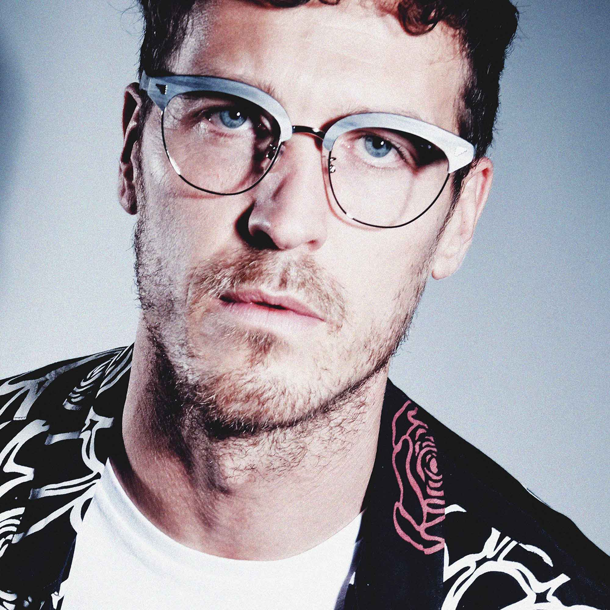 Male model wearing joiuss malcolm grey wood glasses