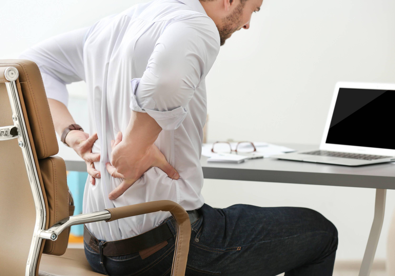 man suffering from backache in office|lower back pain psoaz muscle