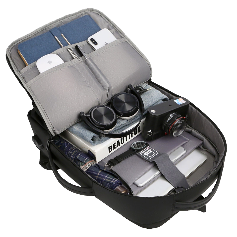 Main Compartment of our epic travel expandable laptop backpack filled with various travel items