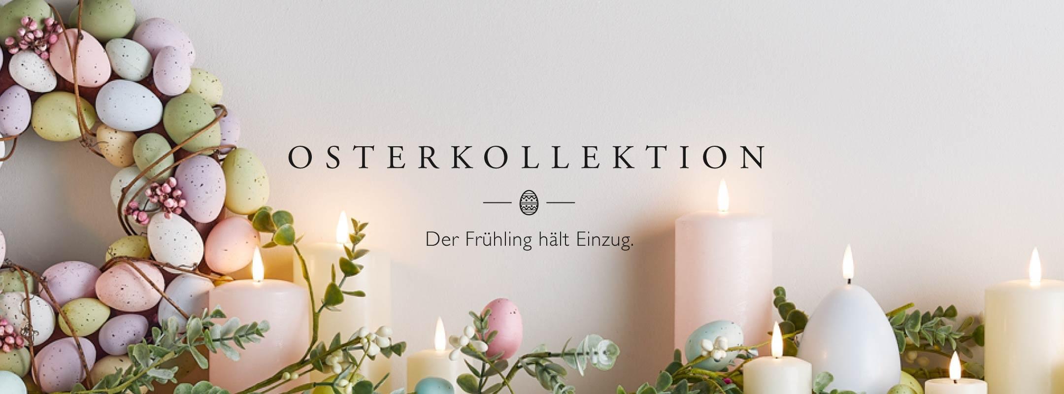 Osterkollektion pastellfarbene LED Kerzen und Osterkranz