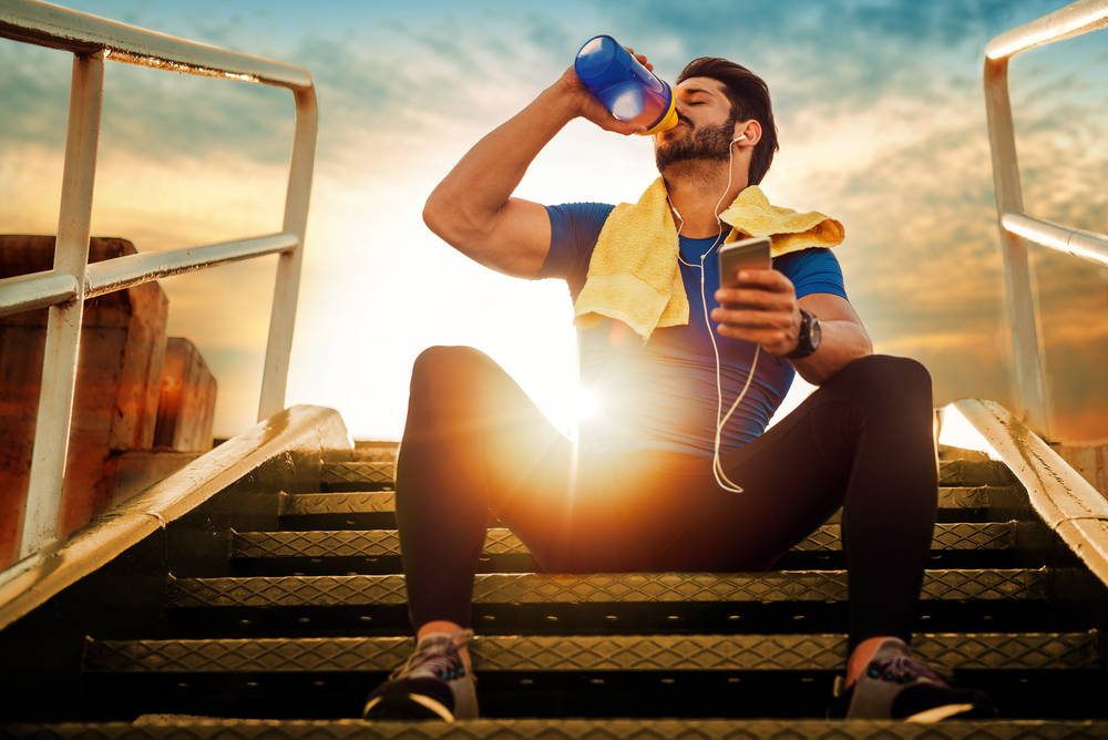 Man drinking from a sports bottle|How to build your collagen with sunwarrior|no hooves no hides no horns