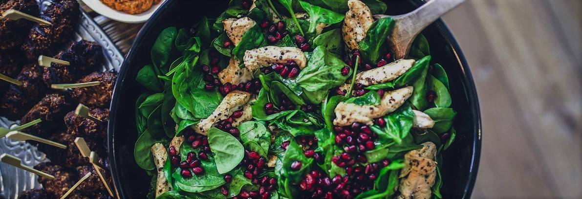 A grilled turkey, spinach and pomegranate salad