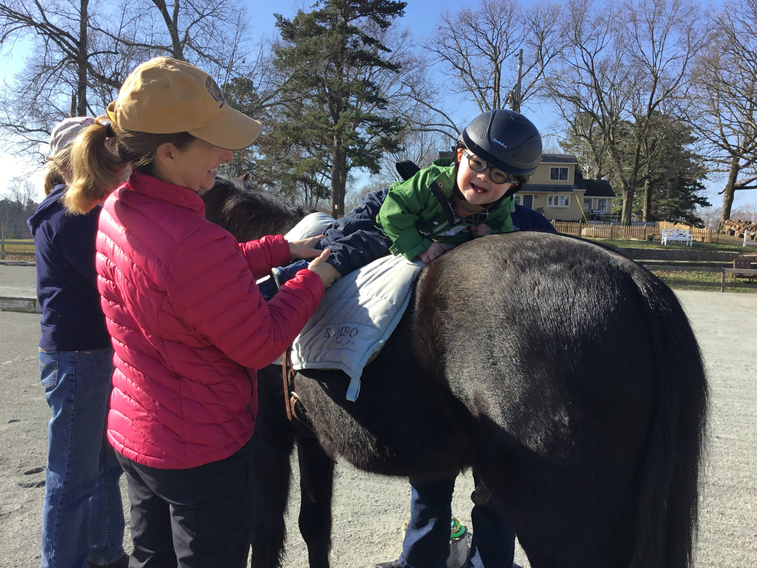 Patient receiving hippotherapy at Shining Hope Farms