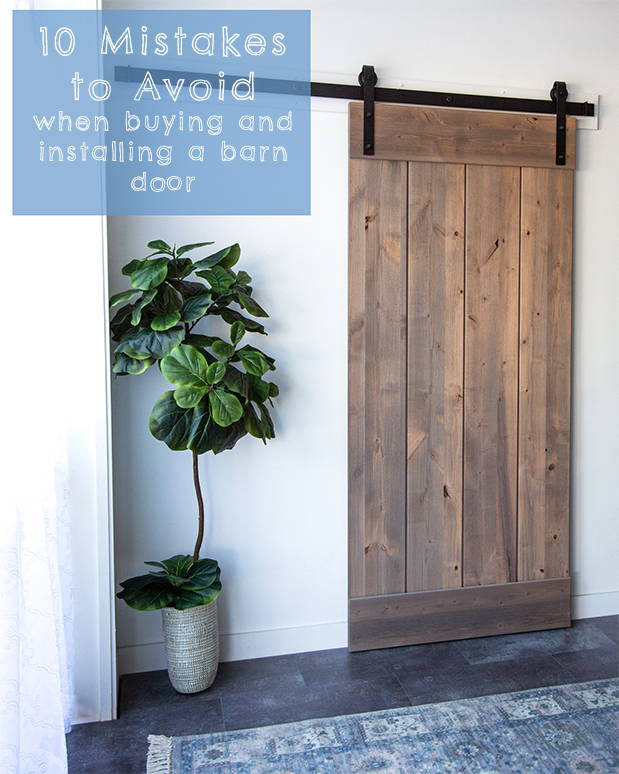 Natural wood barn door with black hardware in a bohemian room.