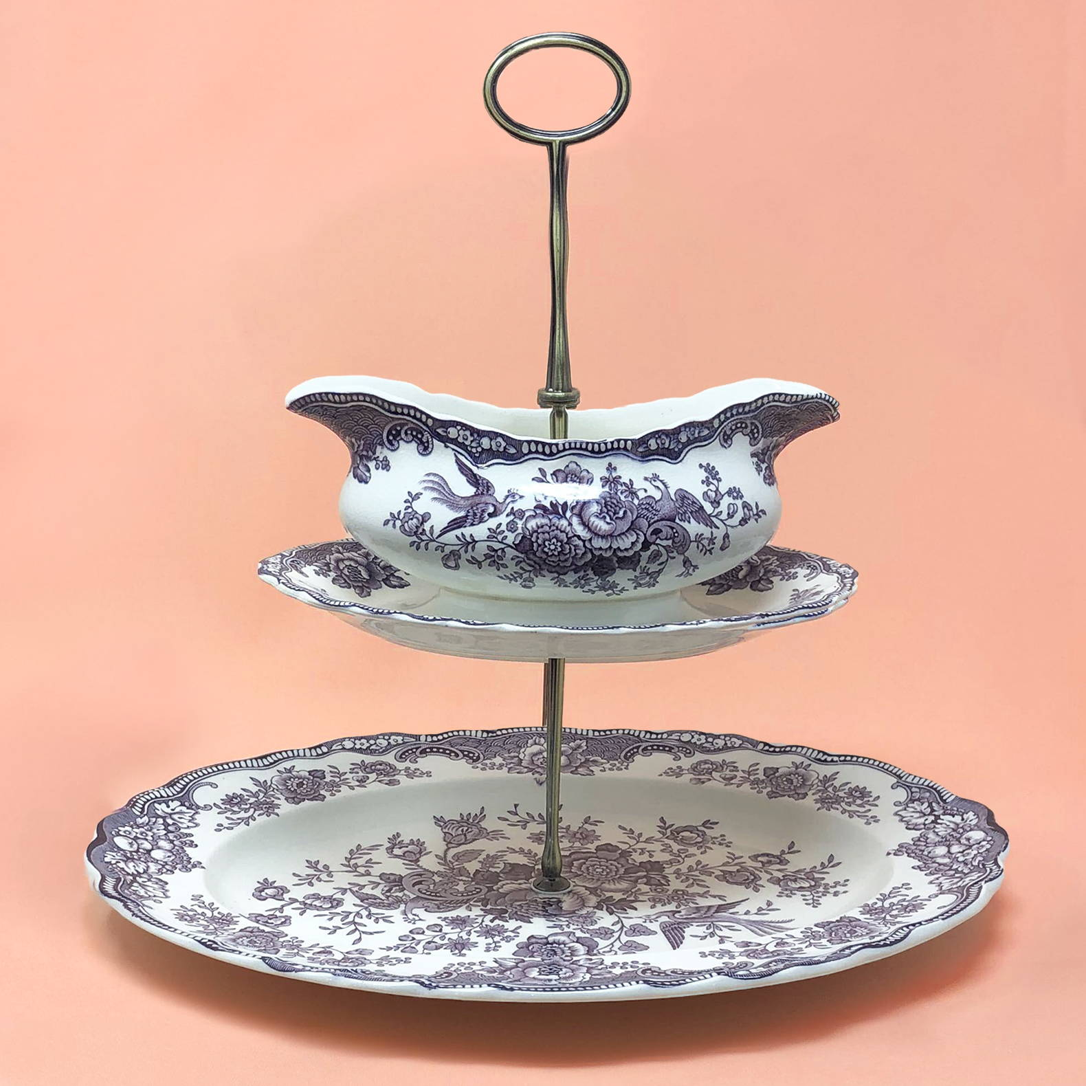 A 2-Tier vintage purple Crown Bristol stand with a gravy boat on top