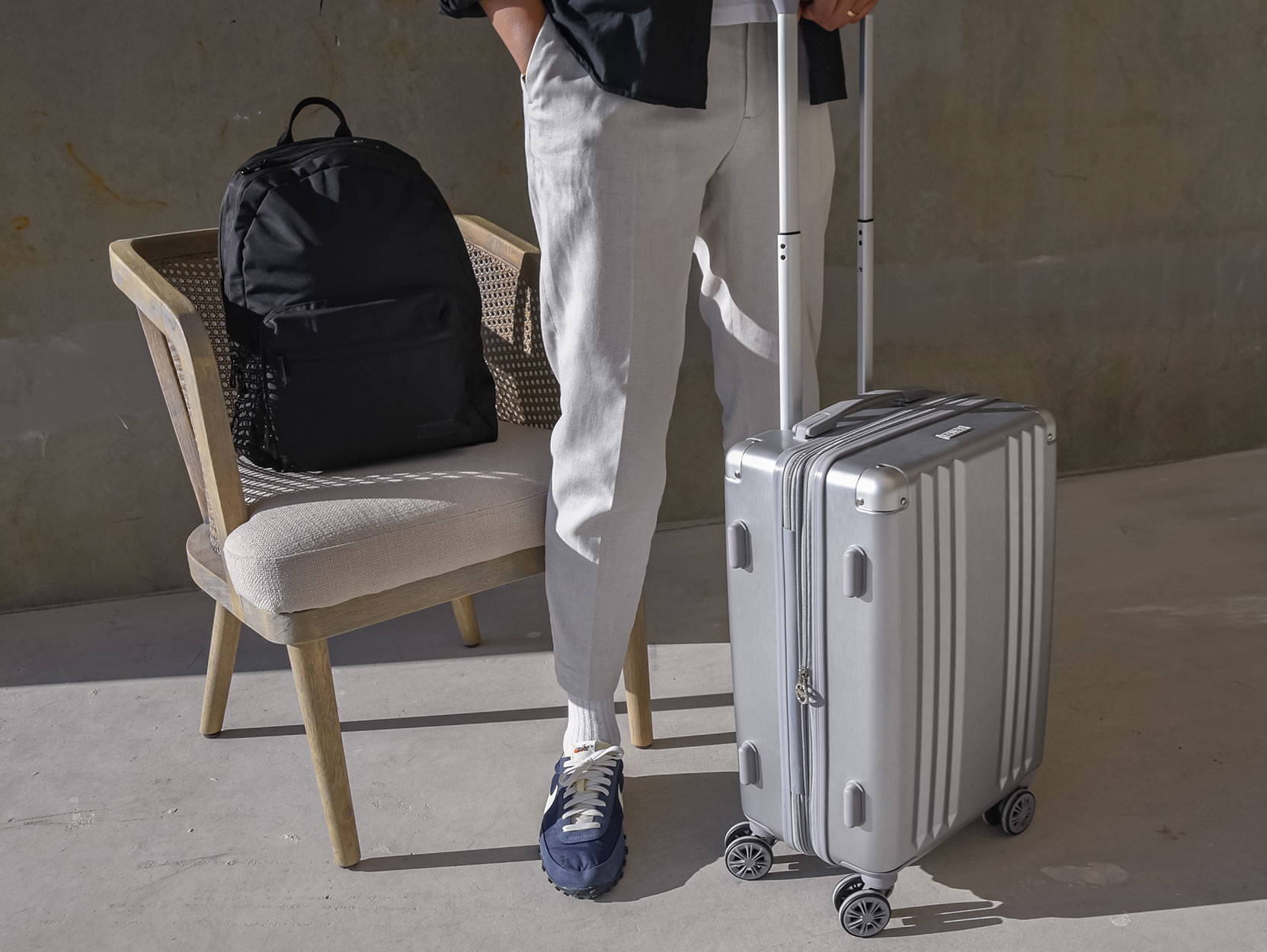 CALPAK Glenroe Backpack in Black and Ambeur Carry-On in Silver.