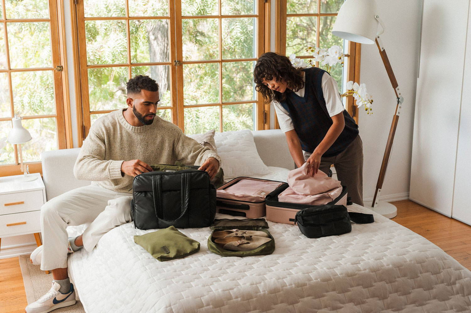 Pierre and Sydney packing for a weekend getaway with their duffel bag and luggage