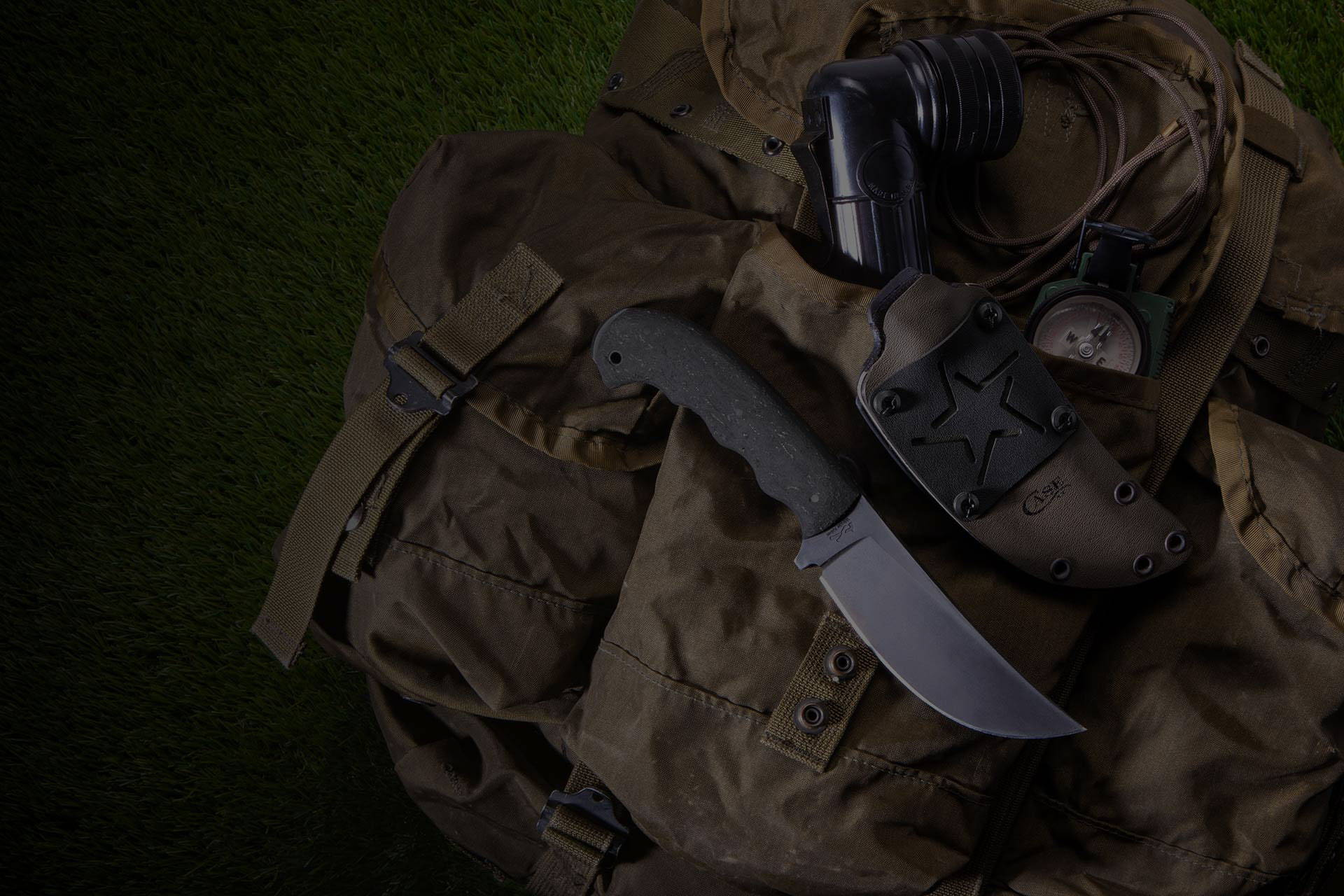 Case® x Winkler Hambone knife with sheath on military style backpack.