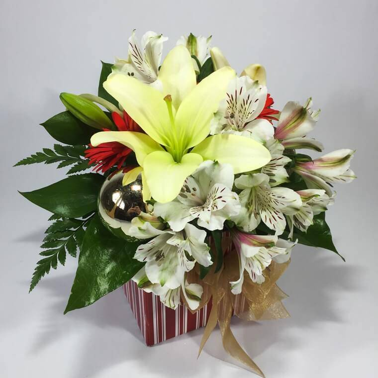 Christmas flowers in a box with baubles