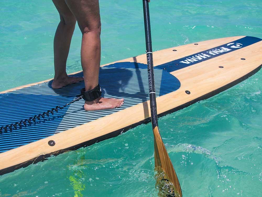 standing on the pau hana big ez vft paddleboard