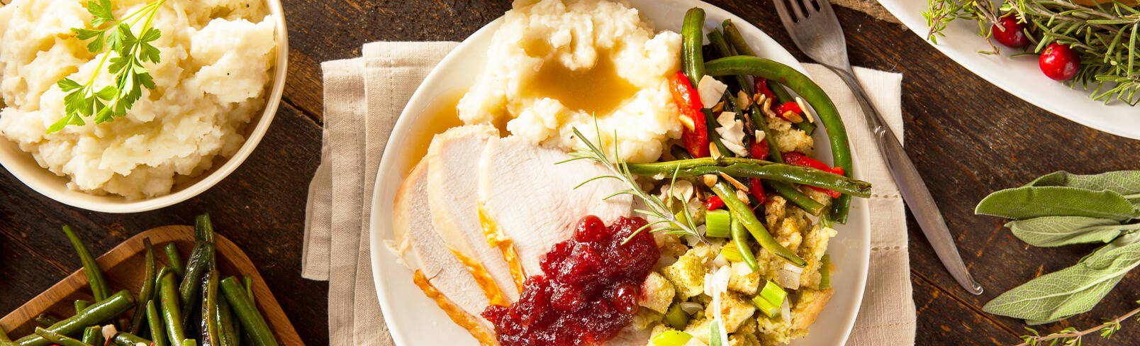 High Quality Organics Express turkey dinner with mashed potatoes and gravy, with stuffing, and cranberry sauce
