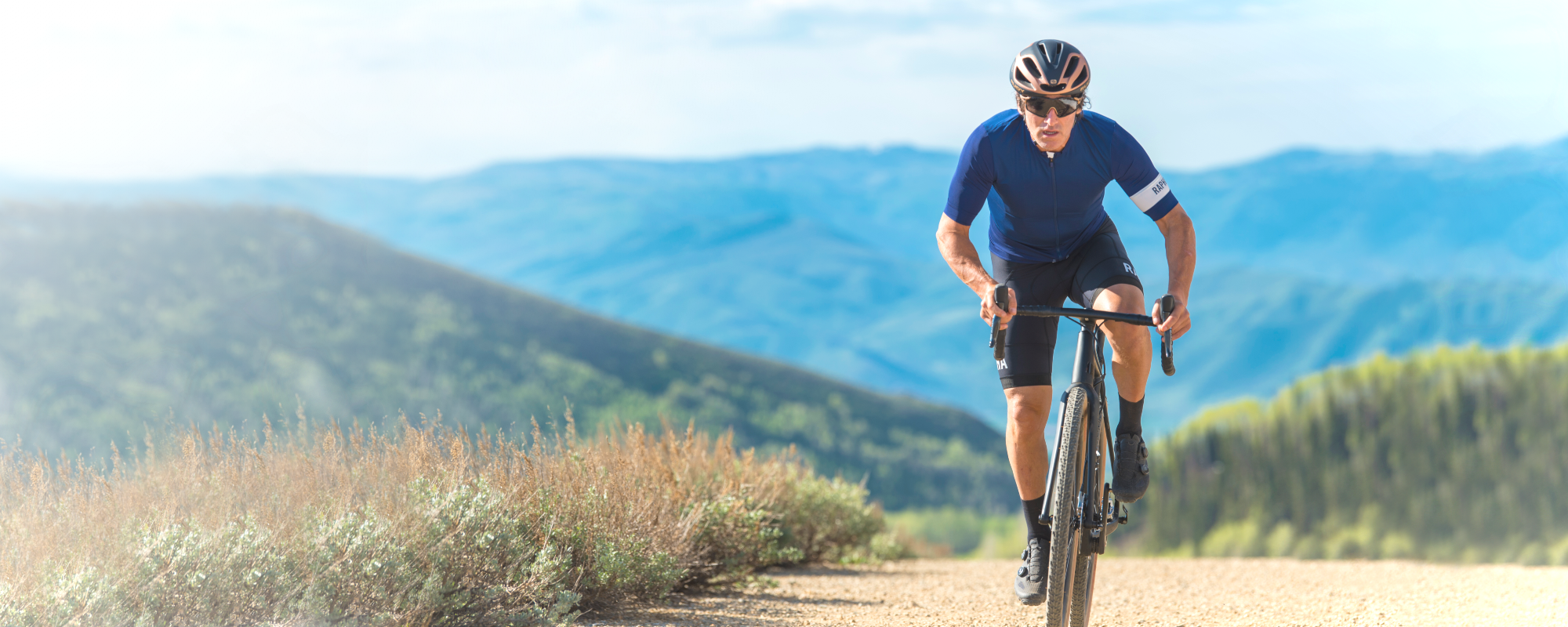 Gravel cyclist wearing Rudy Project Sunglasses & Bike Helmet