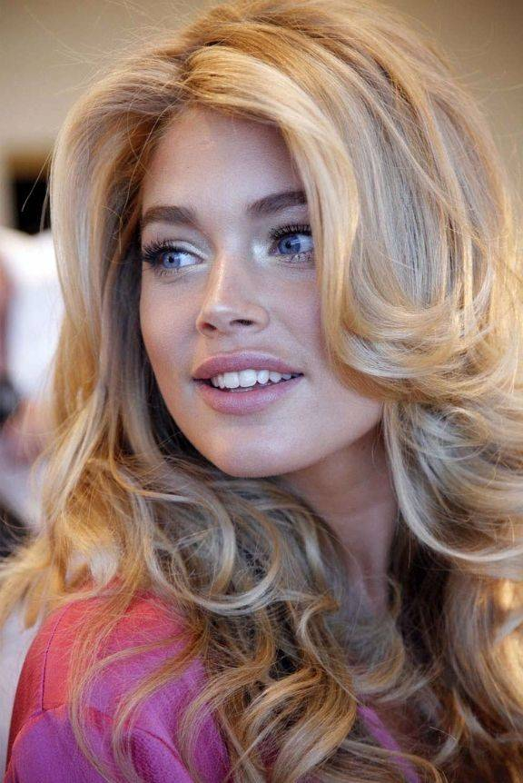 Woman with big blonde curled hair