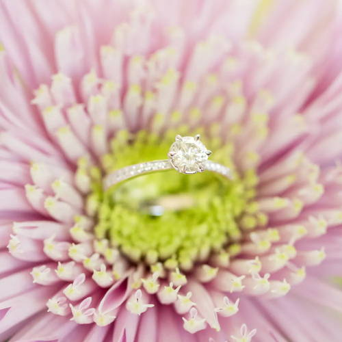 Solitaire engagement ring in a flower