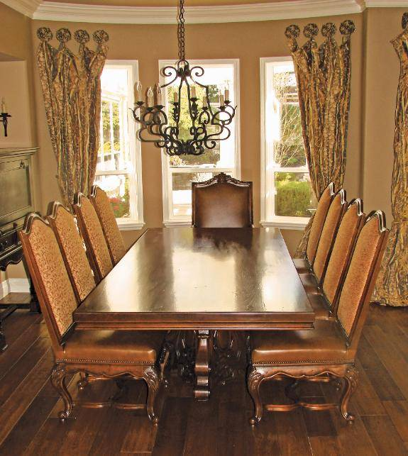 hand carved Via Romani custom Spanish revival dining table