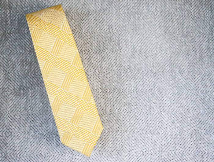 Yellow plaid tie on a gray background