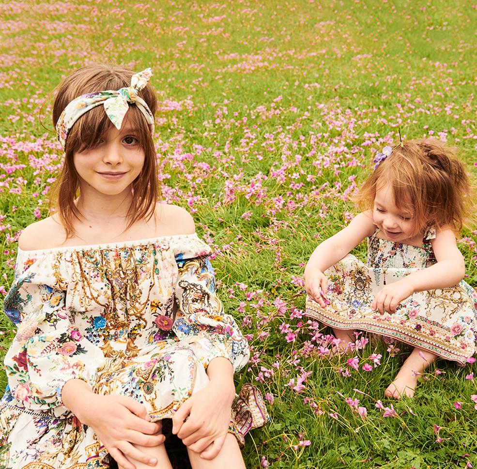Model and Luna wearing CAMILLA By The Meadow kids wear