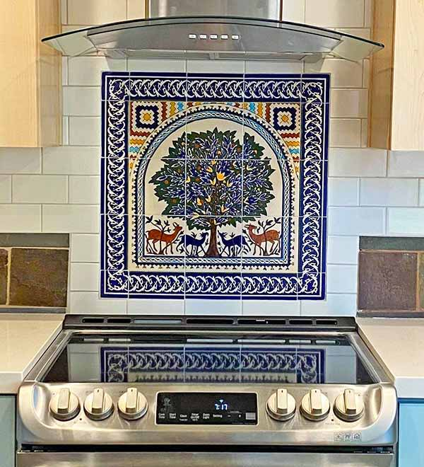 Tree of life tile mural in a kitchen wall backsplash