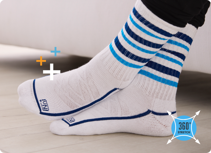Mens Nn+ crew blue and white striped socks worn on model, while on couch.