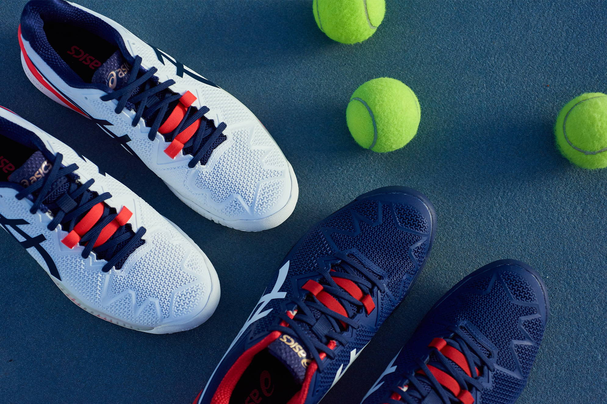 ASICS GEL-Resolution 8 tennis shoes on a court with tennis balls