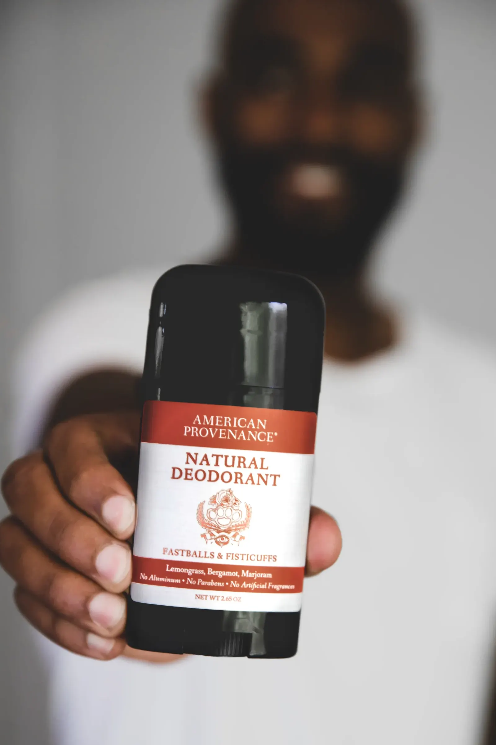man holding deodorant
