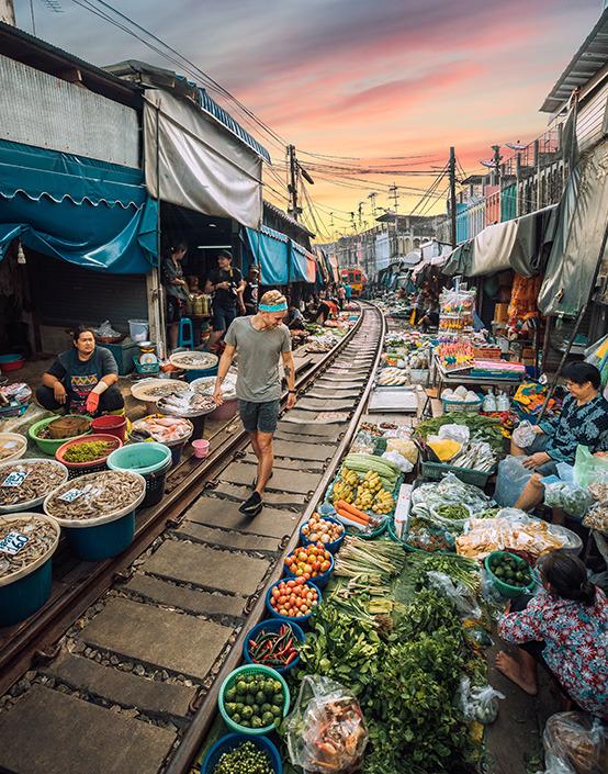 man walking in marketplace at dusk