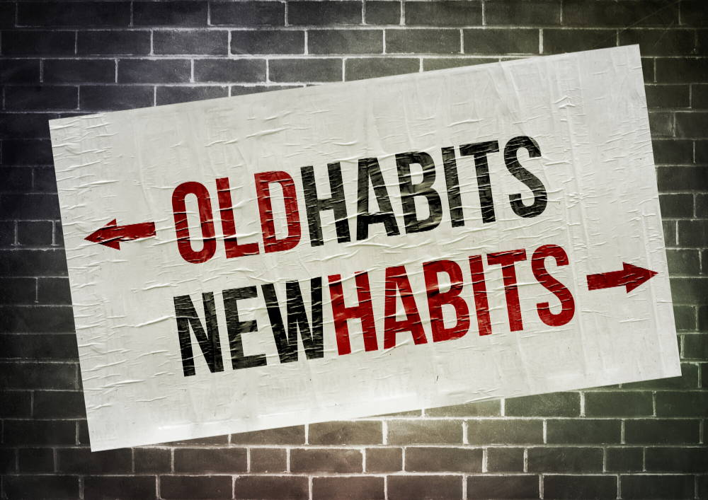 sign  on brick wall says old habits new habits with arrows|How to break up with your bad habits
