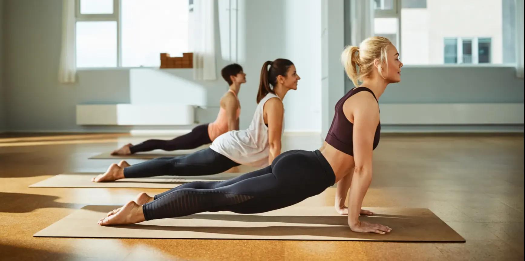 3 Women doing yoga