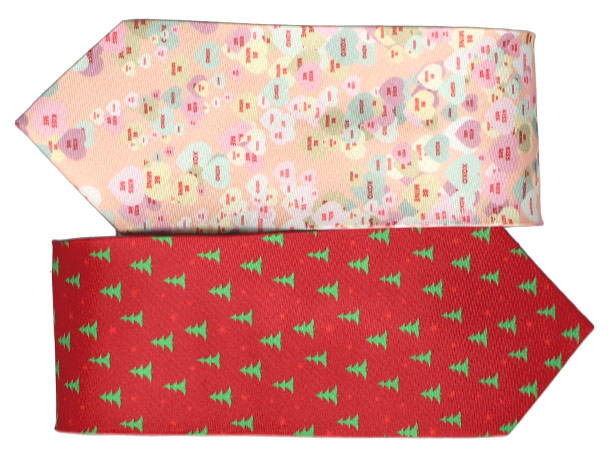 Two classic men's necktie stacked on top of one another. The top necktie is a light orange background with candy heart pattern. The bottom necktie is a red background with green pine trees.